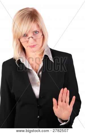 Middleaged Businesswoman Gives Gesture