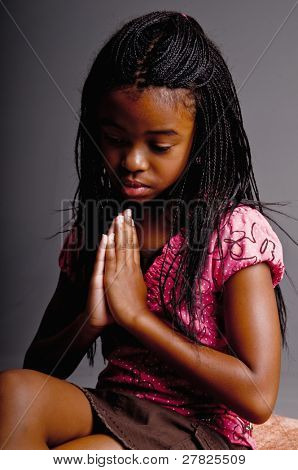 Portrait of a Young African American girl praying