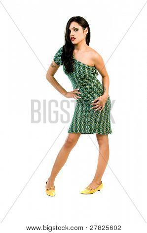 Beauty in high fashion model in a one of a kind retro redesigned off the shoulder green cocktail dress