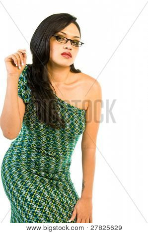 Beauty in high fashion model in a one of a kind retro redesigned off the shoulder green cocktail dress and black rimmed glasses