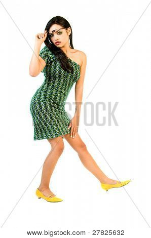 Beauty in high fashion model in a one of a kind retro redesigned off the shoulder green cocktail dress and black framed eye glasses
