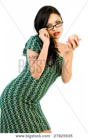 High fashion model in a one of a kind retro redesigned off the shoulder green cocktail dress and black eyeglasses holding the forbidden fruit, the apple