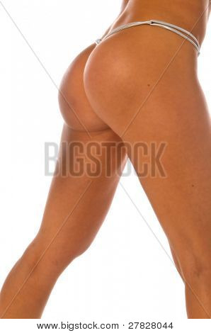 closeup shot of a beautiful and shapely female buttock in a thong