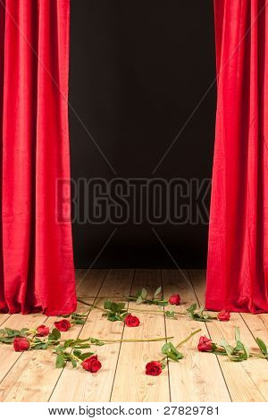 stage theater with red curtain, wood floor and roses