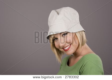 Blonde In White Hat Smiling