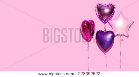 poster of Air Balloons. Bunch of colorful purple, pink, blue heart shaped foil balloons on pink background. Lo