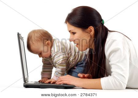 Mother And Baby Girl Having Fun With Laptop