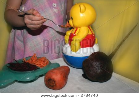 Feeding Teddy With Carrots