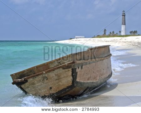 Boat Beached On Dry Tortugas By Lighthouse