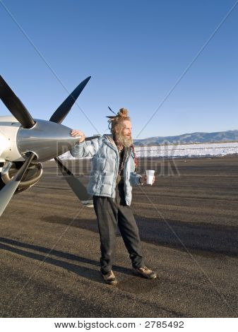 Eccentric Older Man By An Aircraft