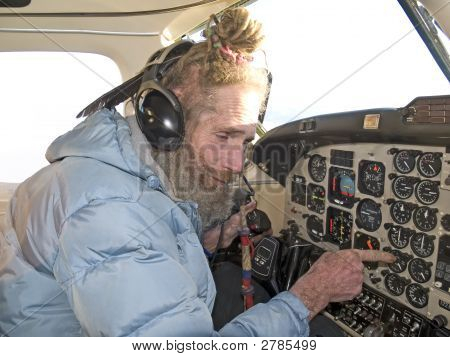 Strange Pilot Reading The Instruments
