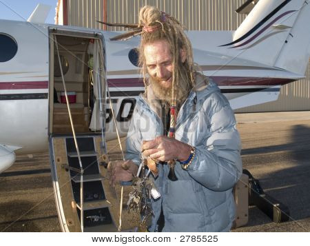 Eccentric Older Man With Keys For His Aircraft