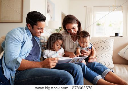 Young Hispanic family of four