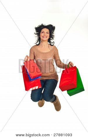 Mulher feliz Shopper pulando