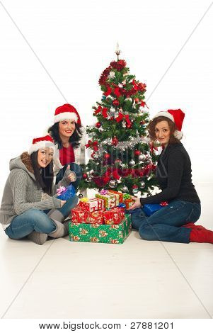 Cheerful Women With Christmas Gifts