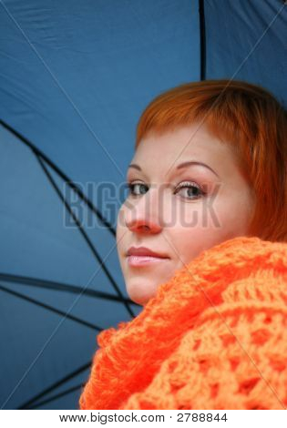 Young Red-Haired Woman With Umbrella