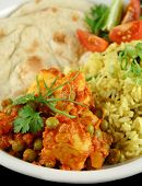 stock photo of indian food  - Indian pea and potato curry with tumeric rice and a side salad - JPG