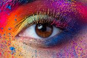 Close Up View Of Female Eye With Bright Multicolored Fashion Makeup. Holi Indian Color Festival Insp poster