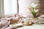 Cozy Easter, Spring Still Life Scene. Cup Of Coffee, Opened Notebook, Pink Knitted Plaid On Windowsi poster