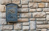 Details Of Classic Mailbox On Stone Wall poster
