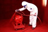stock photo of paint spray  - Industrial paint spraying in a factory - JPG