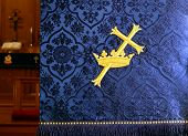 Close-up Of A Gold Cross Through A Crown On A Traditional Indigo Church Advent Lecturn Parament With poster