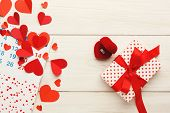 Valentine Background With Red Paper Hearts Border, Giftbox And Ring In Red Box With Copy Space On Wh poster