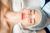 The Doctor Cosmetologist Makes The Rejuvenating Facial Injections Procedure For Tightening And Smoot poster