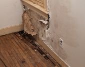 foto of leak  - a water damaged interior wall in an old house - JPG