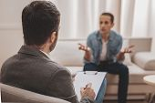 Psychologist Wearing Grey Jacket Listening To His Anxious Client poster