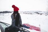 Young Adult Woman Traveler Sitting On The Hood Of The Suv With Usa Flag. Car Travel poster