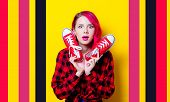 Young Pink Hair Girl In Red Tartan Shirt And Gumshoes. Portrait Isolated On Yellow Background poster