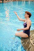Adult Beautiful Woman Making Water Splash At The Pool.enjoying Summer. Caucasian Woman Having Fun Ne poster
