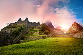 View Of The Stone Ruins Machu Picchu At Sunrise. In The Background Huayna Picchu Mountain In The Clo poster