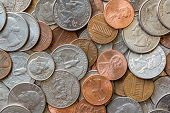 Close-up Of A One Cent, 10 Cent And A Quarter Coins Us Coins poster