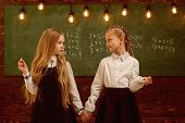Back To School. Happy Small Girls Back To School. Back To School Concept. Modern Schooling And Back  poster