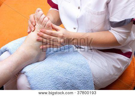 Nurse Treats A Patient's Foot