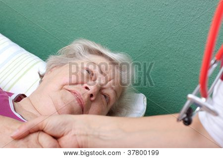 Doctor Welcomes Patient Lying In Bed