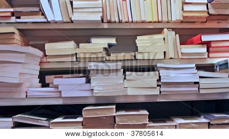 Books Stacked On Top Of Each Other In A Well Stocked Library