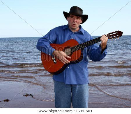Cowboy Singing at Ocean