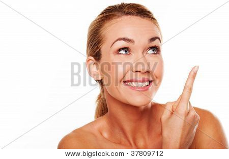 Happy Woman Pointing Upwards