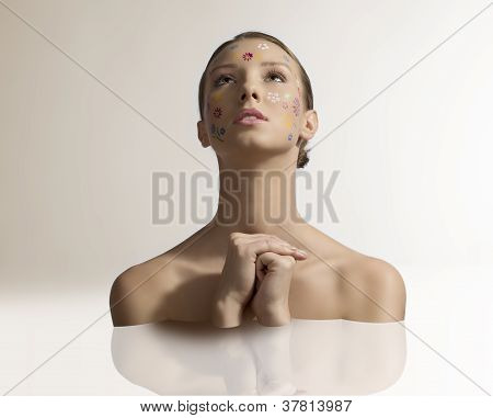 Pretty Girl With Floral Make-up In Prayer Position