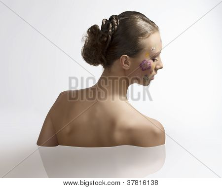 Pretty Girl With Floral Make-up Turned Back