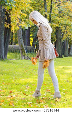 Beautiful Woman Walking In Park