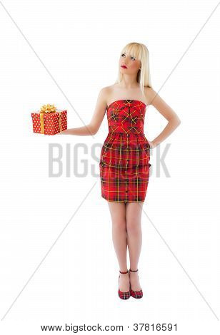 Beautiful Woman Holding Gift And Looking Up At Copyspace