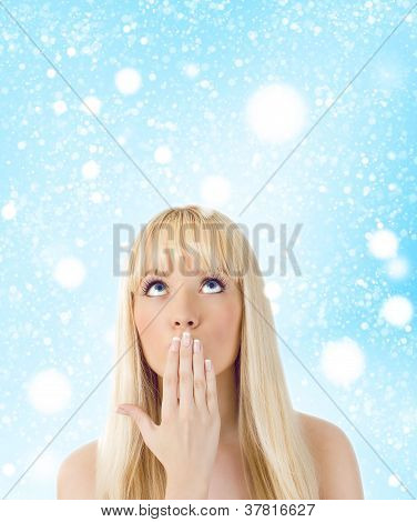 Surprised Woman Looking Up At Snowflakes