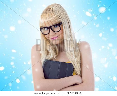 Young Girl In Glasses Hugging Her Book Tightly. Snowflakes