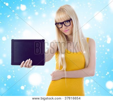 Woman Showing Tablet Computer Screen Smiling Wearing Glasses. Snowflakes