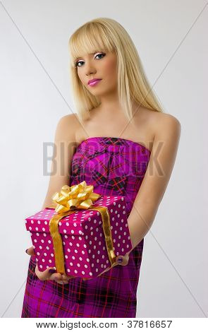 Beautiful Blonde Girl Holding Christmas Gift In Pink Dress