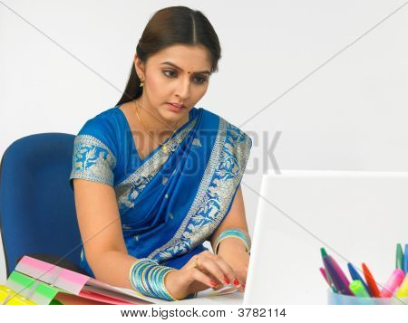 Female Business Executive Working On Her Laptop